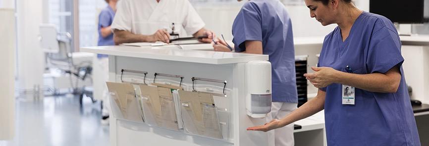 Nursestation sanitizing hands healthcare