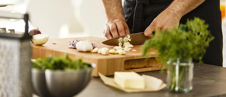 Smelly kitchen hands cutting garlic